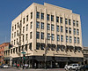 The Colfair Building, built in 1904 and remodelled in 1929. Art Deco with zig-zag Moderne chevron detailing. Notice the classic pediment over the left side doorway. Look for another image of just the doorway. File No. OldPas4459