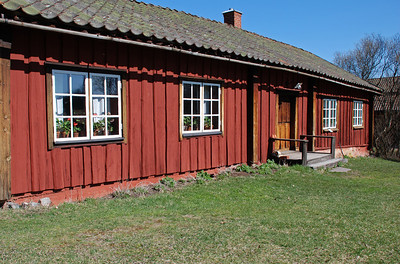 Red wooden cottage in Sweden