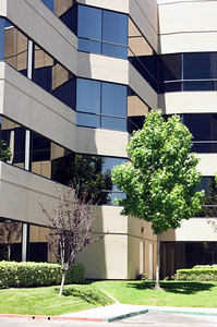 A glass and stucco constructed American office building