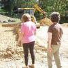 Pat and Debbi watching the foundation hole take shape.