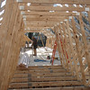 Looking from the garage trusses into the house trusses.