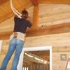 Ian Haxton helping me put up cedar siding on back porch.