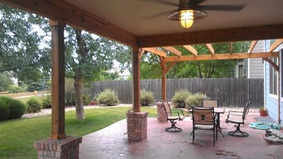 A porch and pergola addition offers both a covered area and an open sky dining space.