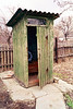 An outhouse with a window.
