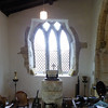 """We were quite enchanted by this window at the east end of the north aisle. It looks so crooked!<br /> This church had an exhibition highlighting the """"past, present and future"""". Some of the old sewing machines were pleasantly remembered."""