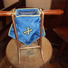 The collection, or offertory, bags are used for taking the collection from the congregation at services. Taking collection has been taken from an idea in the Old Testament by which people paid one-tenth of their wealth, at first in kind and later in money, to maintain the church and to pay the priests. This example has a rather nice wooden stand.