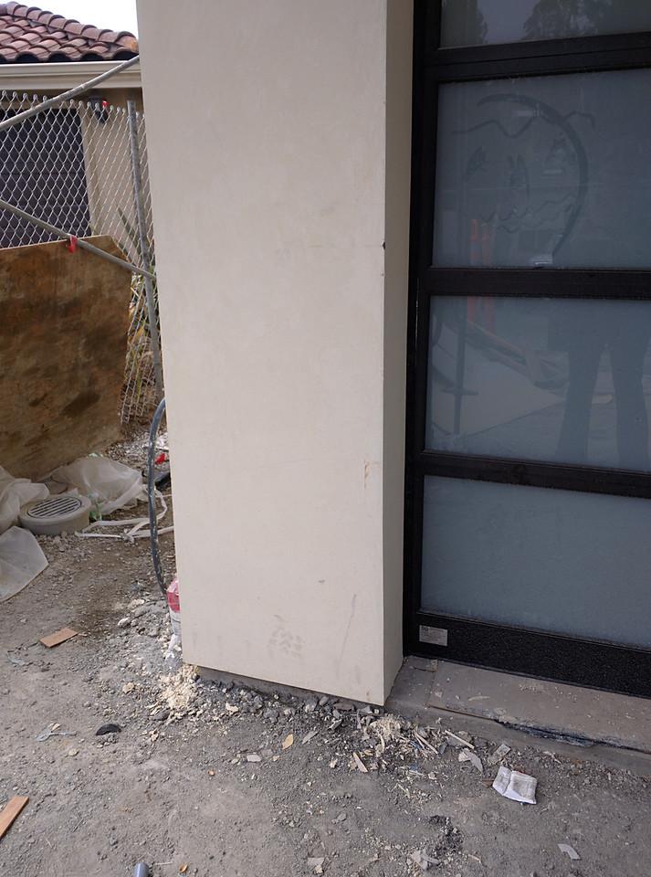Damage to stucco @ garage door