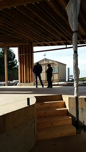 "Discussing stuff with Mark Boyle, my project super. He's absolutely wonderful, and he gets nervous when we're 1/4"" off. I like that in a project super. This house is built to very small tolerances, based chiefly on mathematical formulas . . . that actually work! We have two sections of roof, 1 is 1:12 to the south, the other is 1:8 sloping east and 1:24 sloping north. That creates the wonderful large window over the front entry. It's just geometry!"