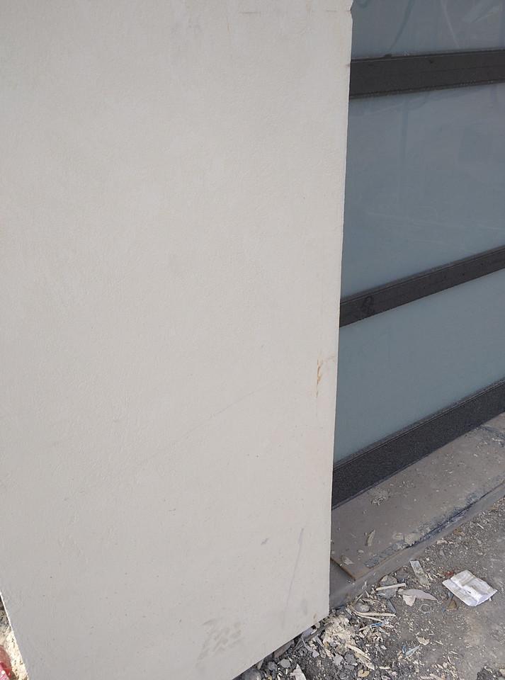 Scarring and chipping left of garage door