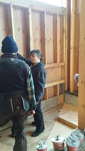 Conferring with Marc Brenner, my plumber, in the master bath shower room