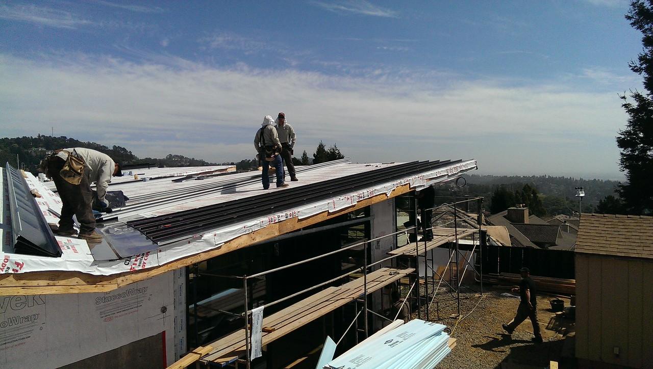 2015-03-30 Roofing begins