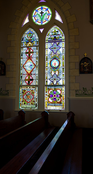 Stained glass window. Inside St. Mary's Catholic Church in High Hill, Texas.