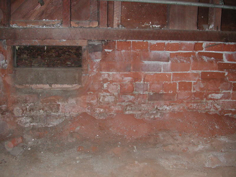 Foundation vent below sill plate at south wall in front of bay window. Alex's photo in 2010