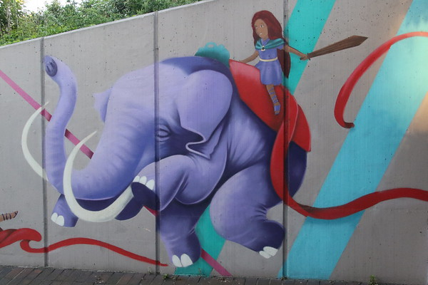 Purple Elephant on the subway to the station.