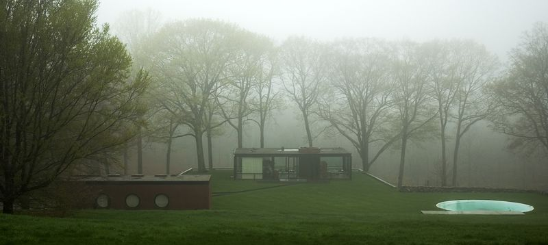Glass house in mist.
