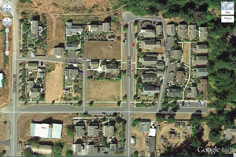 Umatilla Hill, Port Townsend, WA<br /> 10 Cottage Pocket Neighborhood (right of photo) surrounded by compact single family and accessory dwelling units.