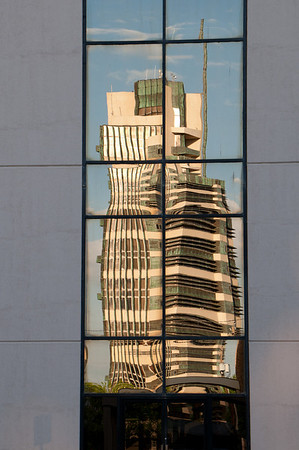 Price Tower in a reflection from the 66 Federal Credit Union Building in Bartlesville Oklahoma.