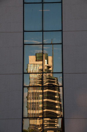 Price Tower in a reflection from the 66 Federal Credit Union Building in Bartlesville Oklahoma