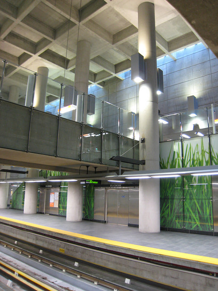 Digital art, concrete, and skylights at De la Concorde station, Montreal metro.