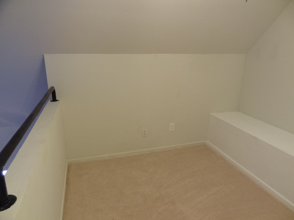 This wall in the loft area has cable outlets for use as a home office and computer workstation.