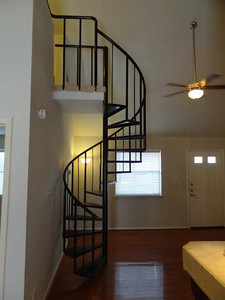 The spiral staircase leading to the loft.