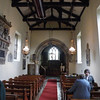 Looking down the nave toward the chancel. The pews are 20th century.