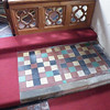 Coloured floor tiles at the altar rail. We have seen this kind of tile in ancient abbeys before.