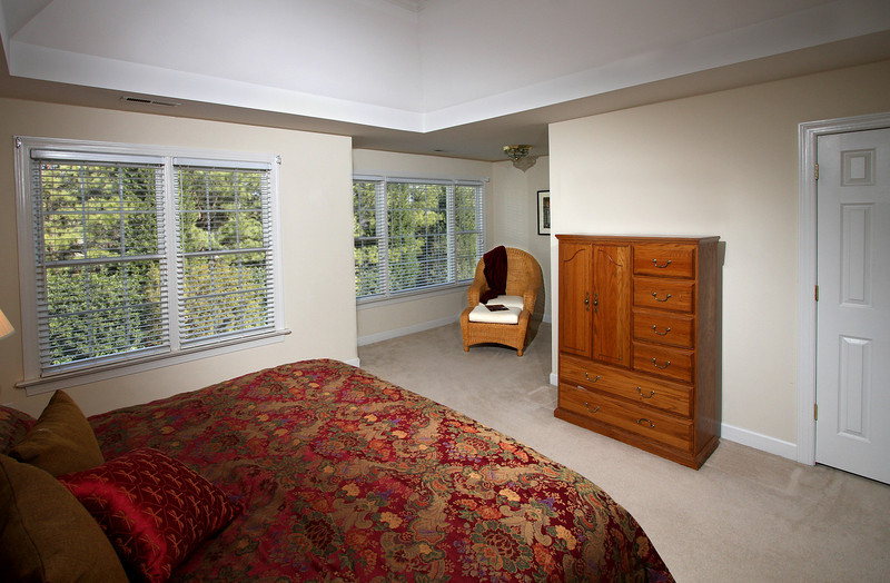 Master Bedroom and sitting area with built-in-wall bookshelves. Windows face due East for morning sun!