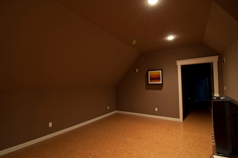 upstairs media room. We'll make this a bedroom for the boys to share by making a closet instead of attic storage down the hallway and dormers or roof windows for safety & light. Flooring is cork tiles.