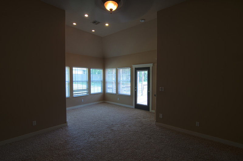 master bedroom view to the deck entrance and back yard.