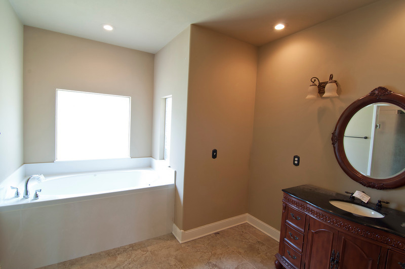 Her bathroom w/ tub and extra space.