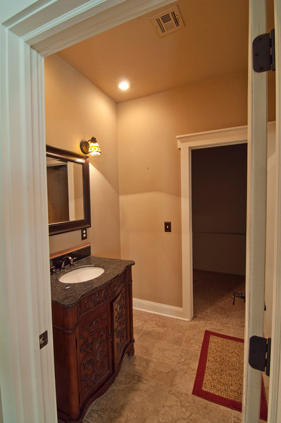HIS bathroom. Toilet is behind the door next to the shower. Electric hot water heater/tank is in his closet.