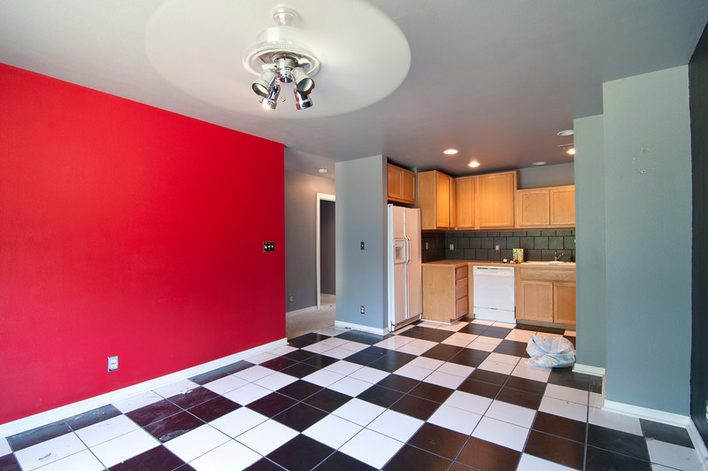 another view. Behind the red wall are stairs to a small rear deck, then to an entry to the garage, storage, and the apartment's own washer/dryer.