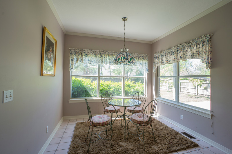 New light. STAT!! Yellow accents, need seating for 6. Glass table and Series 7 or Eames fiberglass chairs- something without crevices for easy cleaning. Remove the window treatments, and trim the bushes.