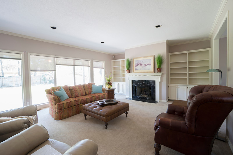 Paint, reface cabinets, tile fireplace wall. Replace marble, remove mantle? Green as the accent color. Gray/silver walls? Furniture: will use our leather sofa/loveseat, coffee burlap cubes, maybe our leather ottoman, TO BUY: green Jacobsen Egg chair, accent/reading light, Noguchi coffee table(?), 3 bar stools (Arne Jacobsen Series 7 style for here and breakfast area for consistency?)