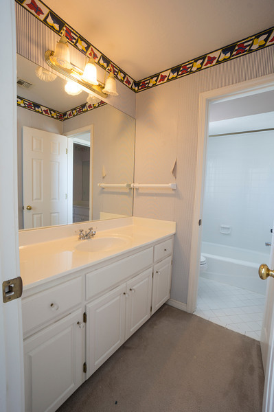 remove wallpaper, replace light, tile floor in ALL of bath, not just toilet/tub.