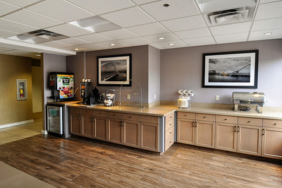 Custom cabinetry, new floor plan and new flooring went into this remodel of the Red Lion Inn & Suites Hotel.  Custom framed original photography by Pamela Root of the Tempe Town Lakes Walking Bridge.