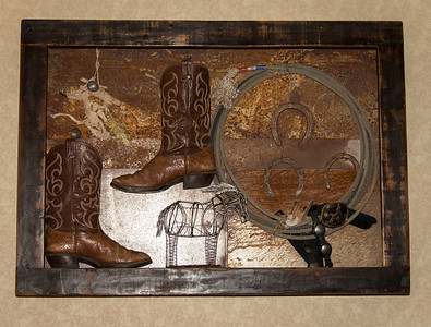 Custom metal shadow boxes were created by K2Design to showcase the eclectic old west contemporary feel of the newly remodeled Red Lion Inn & Suites hotel lobby.
