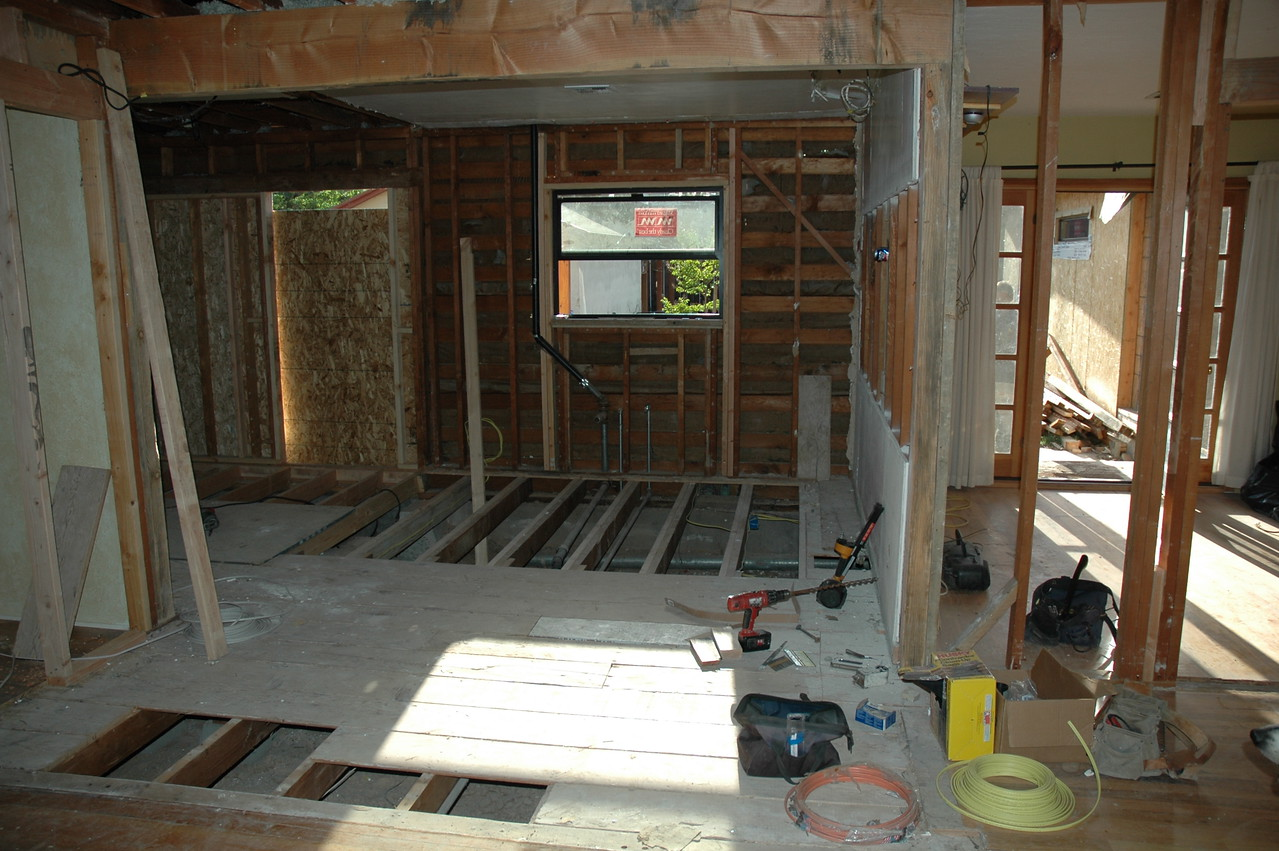 """The view looking into the Kitchen.  The floor was not level, so they added level floor joists.  We also replaced the old 2'6"""" kitchen window with this 4' wide window."""