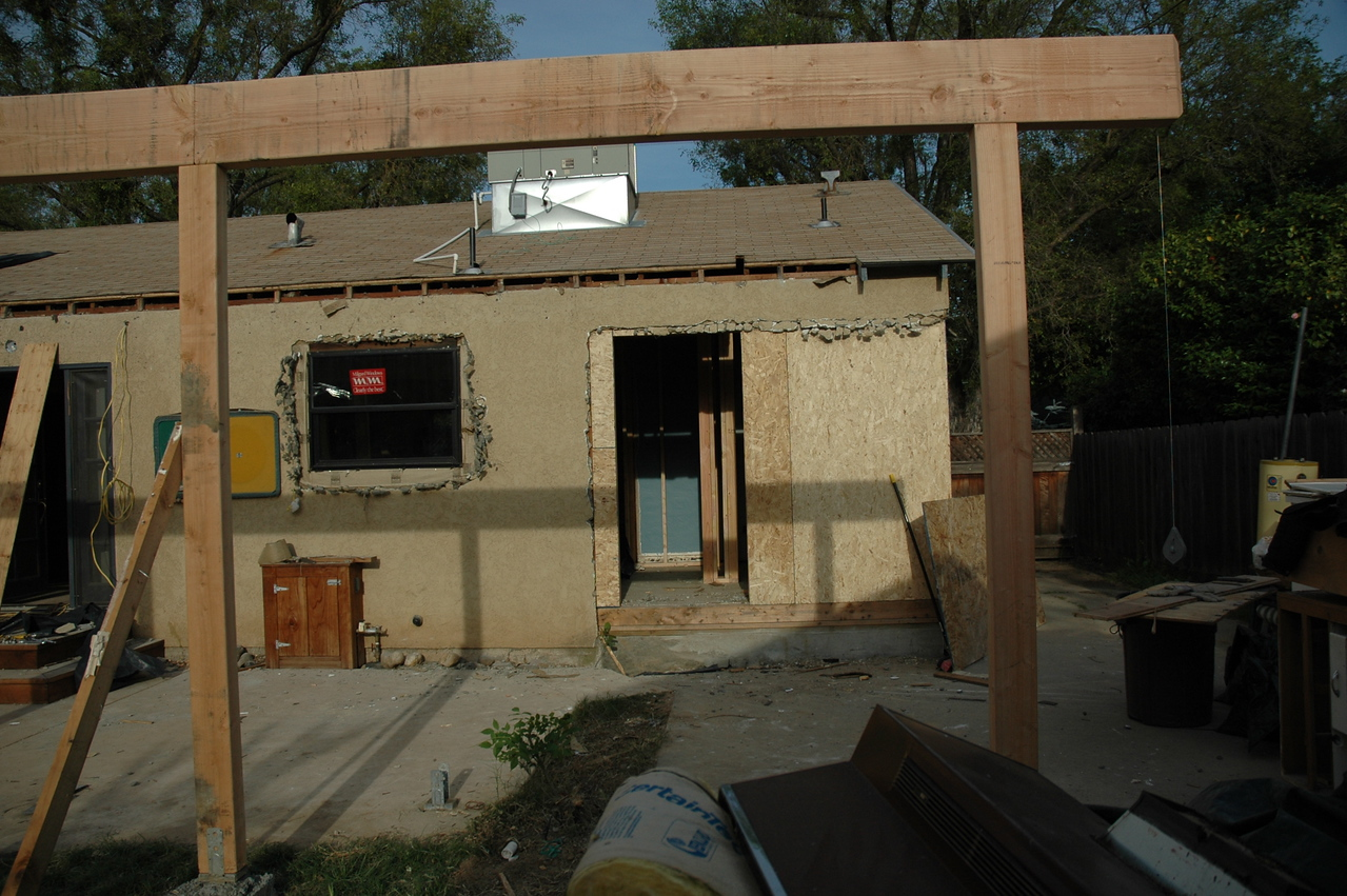 We will soon have a monster sized covered patio.  You can see the new, wider window into the kitchen has been installed, and the right corner of the house has been framed in.