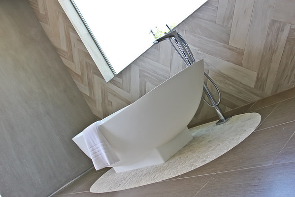 Modern Bathtub with Herringbone Wall Tile
