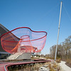 Ornamental red netting above the artificial pond on the east side of the Richmond Olympic Oval.