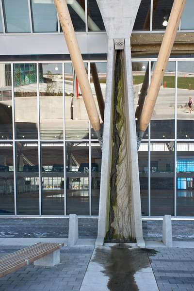 Drainage from the roof of the Richmond Olympic Oval takes place through these unique spouts, with Coast Salish salmon imagery cast into the concrete.