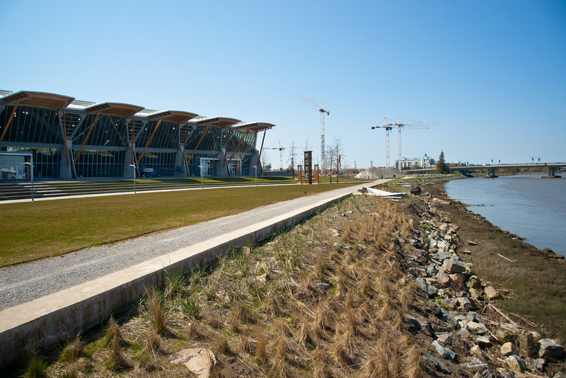 The Richmond Olympic Oval facing the Middle Arm of the Fraser River.