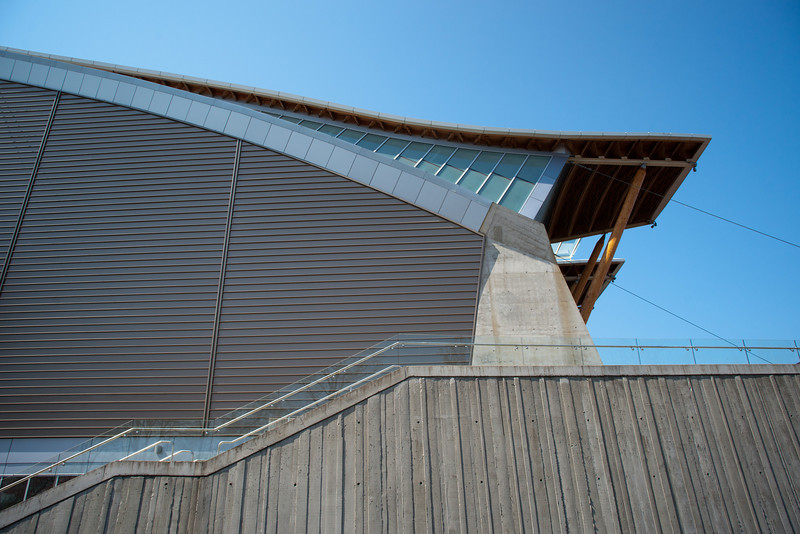 Detail of the east side of the Richmond Olympic Oval.  The main entrance, on the south side, is a full storey lower than the field of play, which is level with the north (river) side.