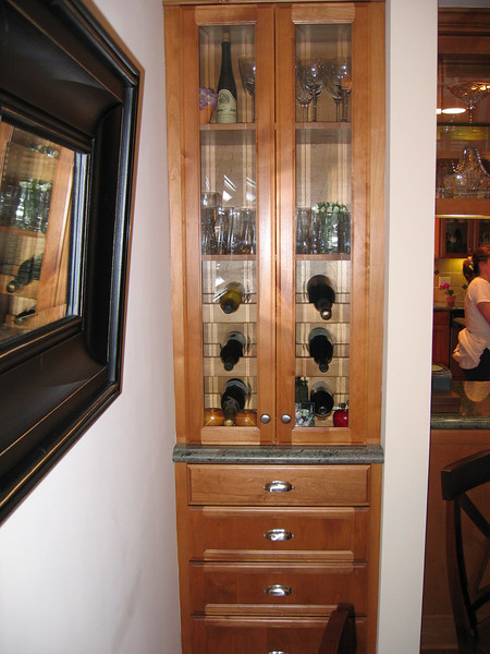 Built in cabinet/wine rack/service in the dining room.