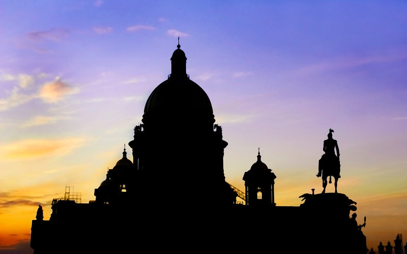 Silhouette of St Isaac's Cathedral and Monument of man on horse, Saint Petersburg, Russia.