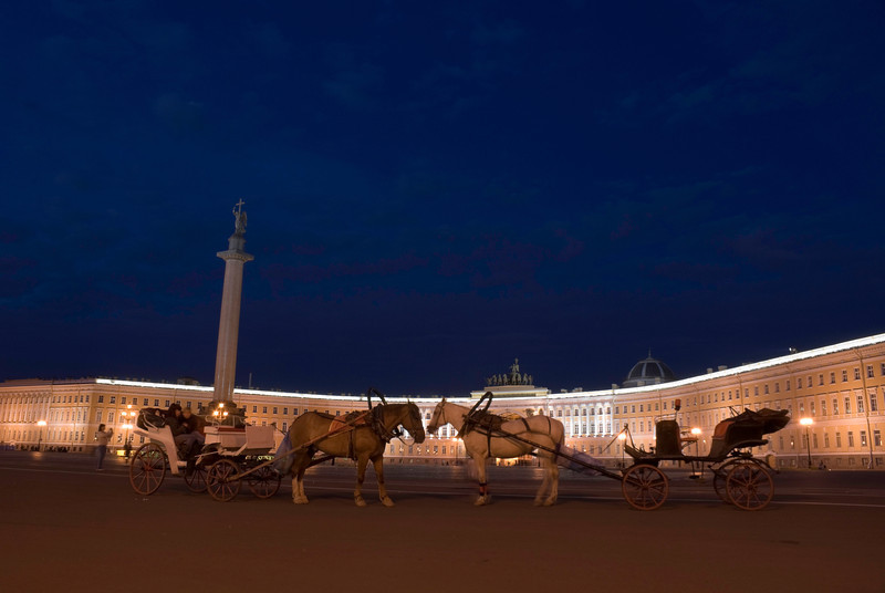 Winter Palace and Alexander column, Saint Petersburg at night. With horses and carriage.