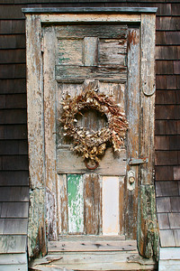 Old rotting door with lucky horseshoe.