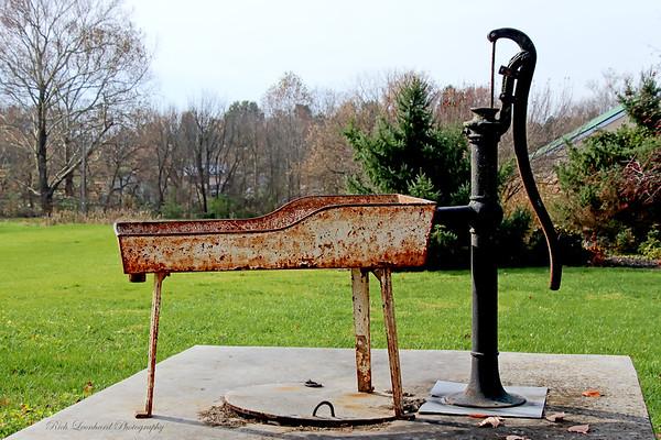 Rusty rustic water hand pump.